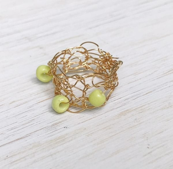 Learn How to Knit with Wire | Learn How to Crochet with Wire | Make wire and bead rings with Vickie Howell. [VIDEO] from her Ask Me Monday series. #knitwithwire #crochetwithwire #crochetwithbeads #knitwithbeads #summerknitting #knittingjewelry #crochetjewelry